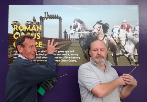 Neil and Richard putting up signs